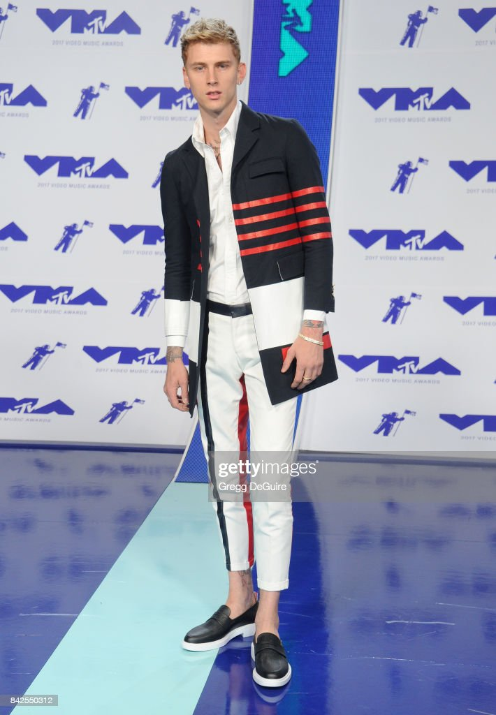 Machine Gun Kelly arrives at the 2017 MTV Video Music Awards at The Forum on August 27, 2017 in Inglewood, California.
