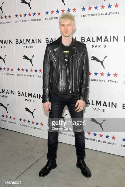 Machine Gun Kelly attends PUMA x Balmain created with Cara Delevingne LA Launch Event at Milk Studios on November 21 2019 in Los Angeles California
