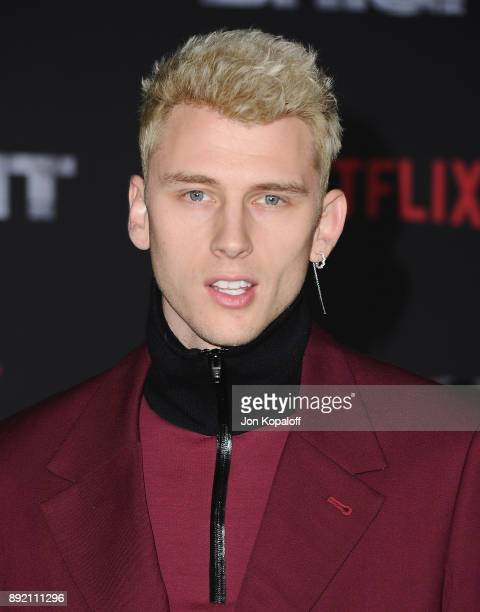 Machine Gun Kelly attends the premiere of Netflix's Bright at Regency Village Theatre on December 13 2017 in Westwood California