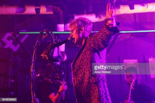 Machine Gun Kelly performs onstage at the John Varvatos x MGK Fashion Week Concert at John Varvatos 315 Bowery Boutique on September 7 2017 in New...
