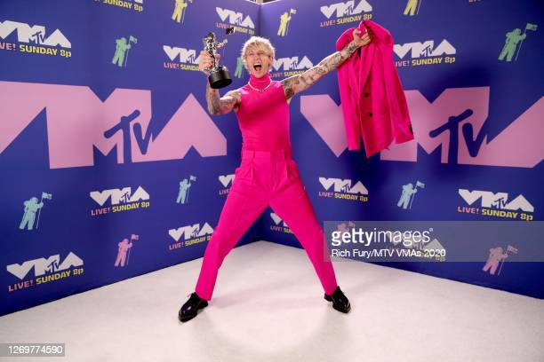 """Machine Gun Kelly poses with the Best Alternative Award for """"Bloody Valentine"""" during the 2020 MTV Video Music Awards, broadcast on Sunday, August..."""