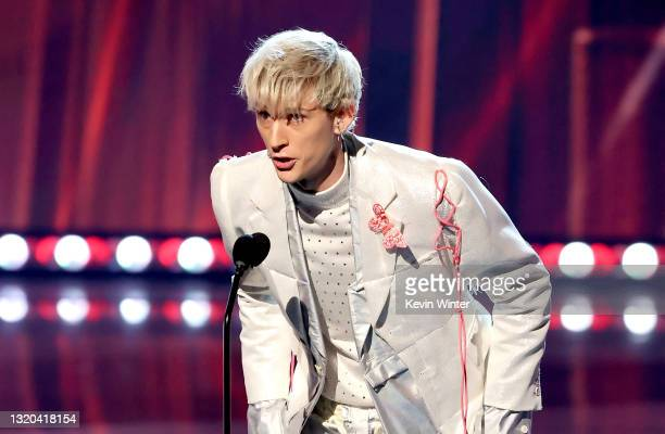 Machine Gun Kelly speaks onstage at the 2021 iHeartRadio Music Awards at The Dolby Theatre in Los Angeles, California, which was broadcast live on...