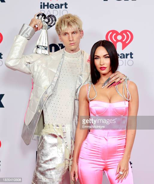 Machine Gun Kelly, winner of the Alternative Rock Album of the Year award for 'Tickets To My Downfall,' and Megan Fox attend the 2021 iHeartRadio...
