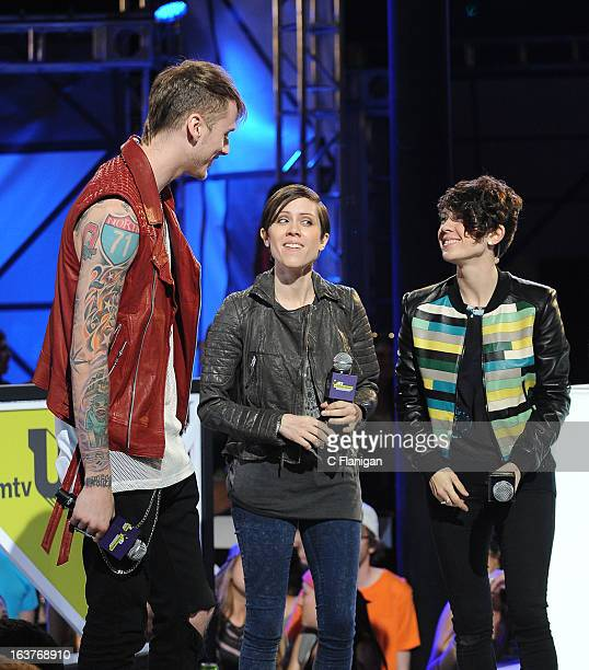 Machine Gun Kelly wins the Woodie of the Year award presented by Tegan Quin and Sara Quin of Tegan and Sara during the 2013 mtvU Woodie Awards on...