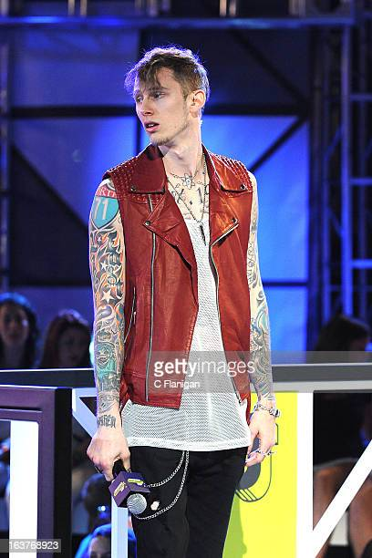 Machine Gun Kelly wins the Woodie of the Year award presented by Tegan Quin and Sara Quin during the 2013 mtvU Woodie Awards on March 14, 2013 in...