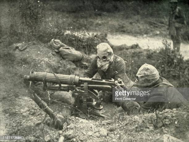 Machine Gunners in Action Wearing their Gas Helmets' Scene from the First World War 19141919 From The History of the Great European War its causes...