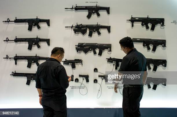 Machine guns and pistols are seen at exhibition booth of Ministry of National Defence Republic of Poland during the 16th Defence Services Asia 2018...