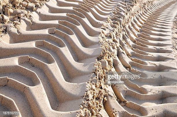 Machine Imprints in Sand
