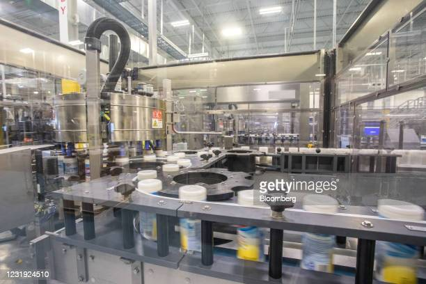 Machine labels canisters of Clorox Disinfecting Wipes at the company's manufacturing facility in Forest Park, Georgia, U.S., on Wednesday March 10,...