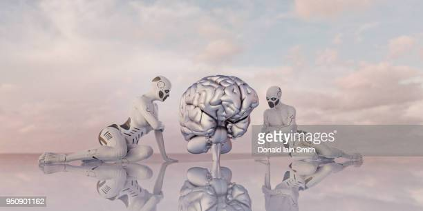 Machine learning concept: admiring female cyborgs sit beside oversized silver human brain