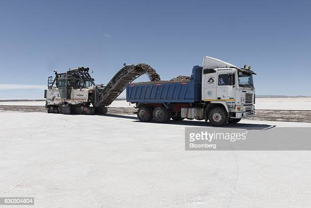 A machine loads soil into a truck during the construction of new industrial evaporation pools inside the Salar de Uyuni in Potosi Bolivia on Saturday...
