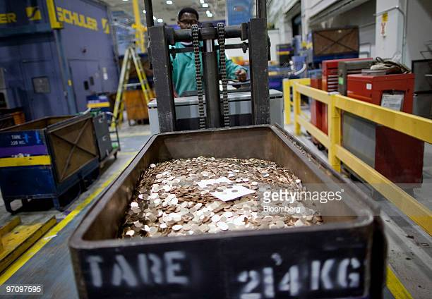A machine operator transports penny blanks at the United States Mint in Philadelphia Pennsylvania US on Thursday Feb 25 2010 US stocks pared losses...