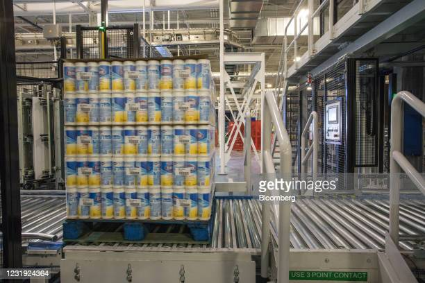 Machine packages canisters of Clorox Disinfecting Wipes on a pallet at the company's manufacturing facility in Forest Park, Georgia, U.S., on...