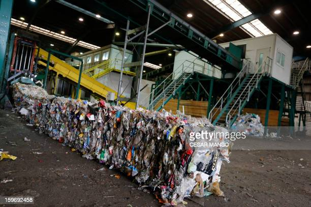 Machine packs garbage for recycling at a waste treatment plant in Burgos on January 18, 2013. AFP PHOTO/ CESAR MANSO