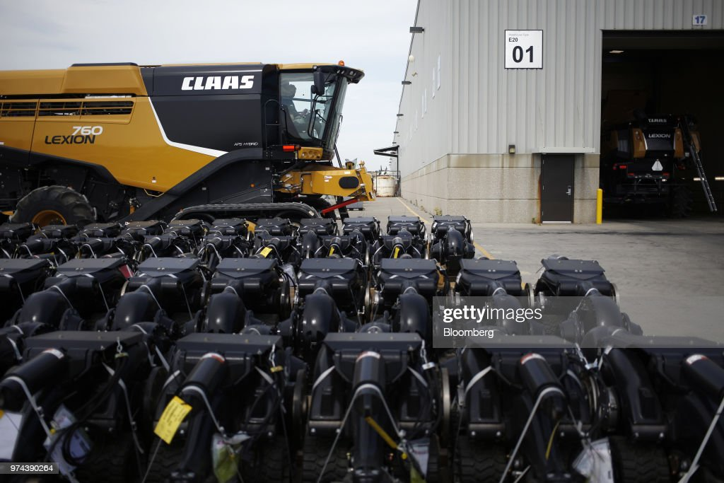 Machine parts sit in front of a combine harvester outside the CLAAS of America Inc. production facility in Omaha, Nebraska, U.S., on Wednesday, June 6, 2018. The Federal Reserve is scheduled to release industrial production figures on June 15. Photographer: Luke Sharrett/Bloomberg via Getty Images