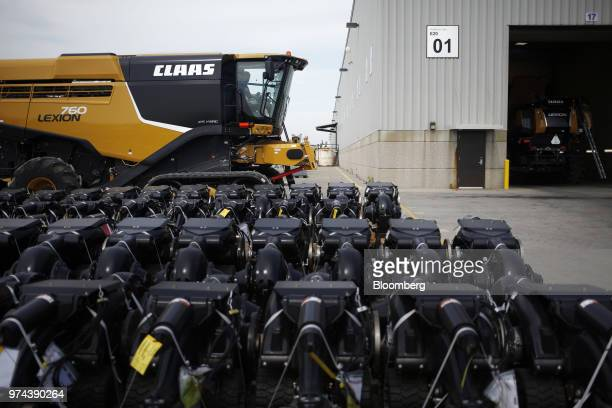 Machine parts sit in front of a combine harvester outside the CLAAS of America Inc production facility in Omaha Nebraska US on Wednesday June 6 2018...
