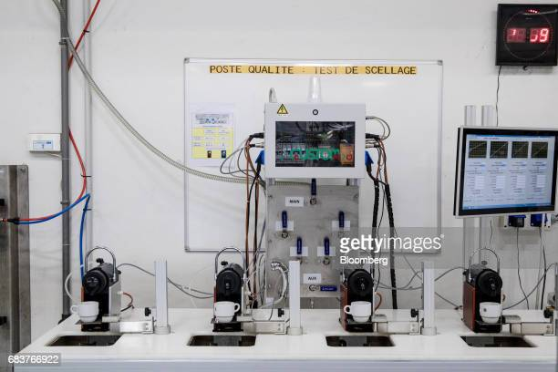A machine performs a check on coffee capsules for sealing quality inside the Carte Noire factory in Laverune France on Tuesday May 16 2017 The...