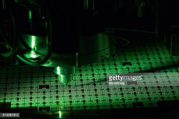 A machine places single solder balls onto a printed circuit board during manufacture at the Infineon Technologies AG microchip and sensor facility in...