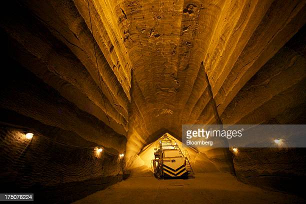 A machine positions a pile of recently excavated potash ore in the OAO Uralkali mines in Berezniki Russia on Thursday March 17 2011 For the first...