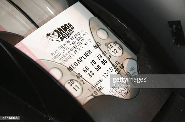 A machine prints a Mega Millions lottery ticket for a customer at a convenience store on December 17 2013 in Chicago Illinois The jackpot is...