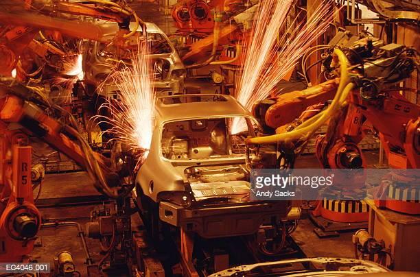 Machine sanding metal auto body before paint job, Michigan, USA