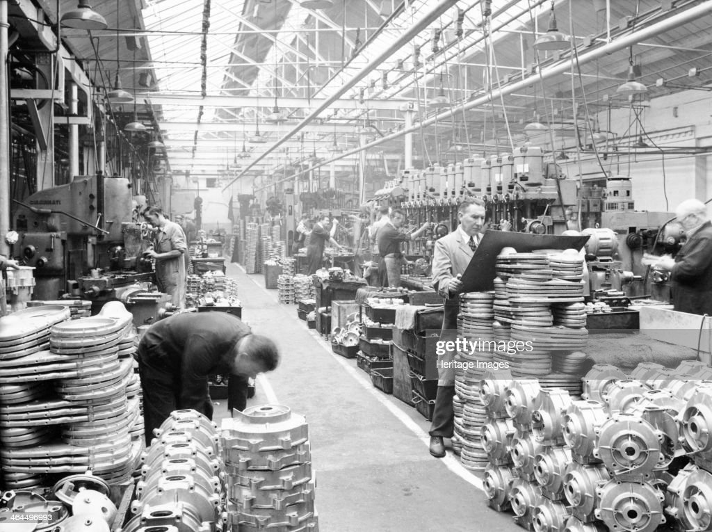 Machine shop at Ariel Motors, c1950. Piles of engine parts for motorbikes including Red Hunter singles.