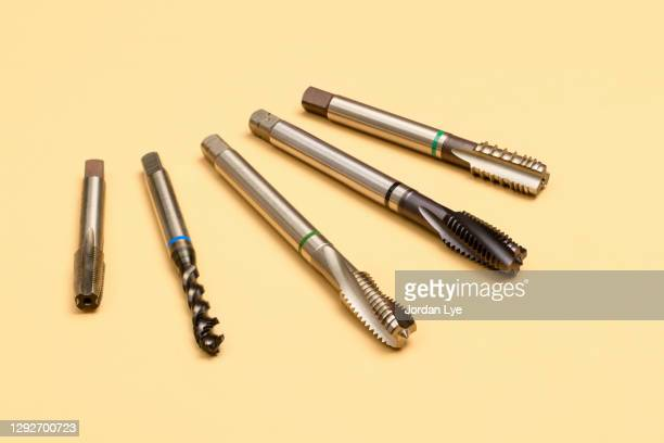 machine taps - beige background stock pictures, royalty-free photos & images