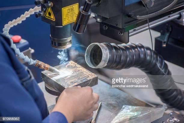 machine tool in metal factory with drilling cnc machines - kunsthandwerkliches erzeugnis stock-fotos und bilder