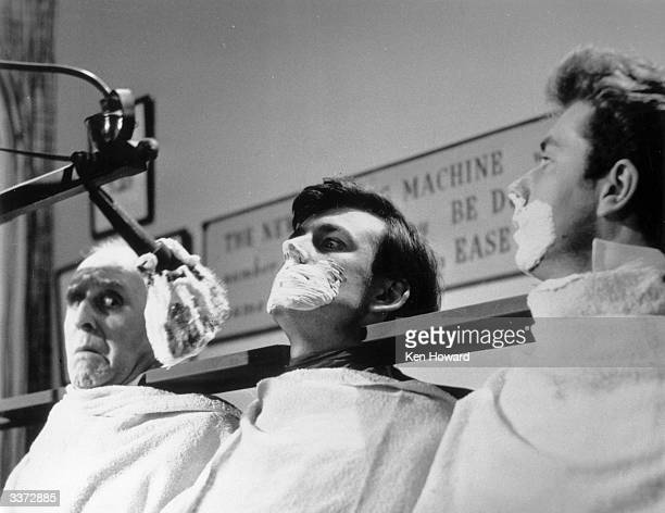 Machine which can shave a dozen men at the same time lathers the faces of a row of actors on an untransmitted pilot show for a proposed television...