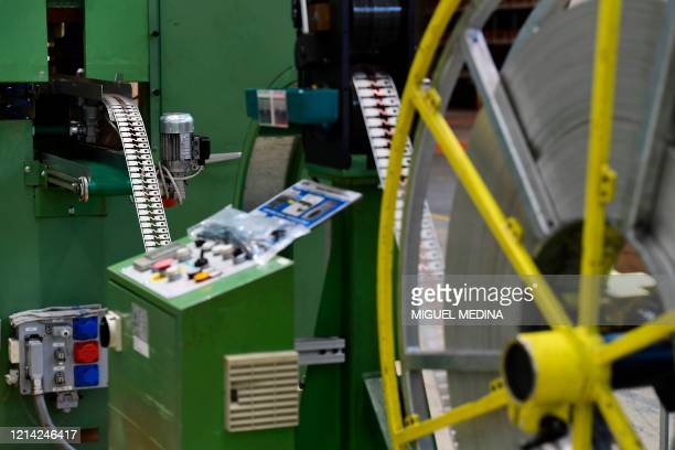 Machine which cuts metal components is pictured at the Codogno-based Italian multinational company MTA, specialized in electromechanical components...