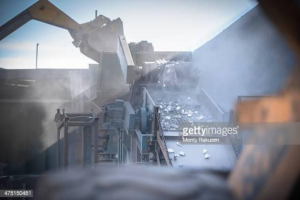 Machinery crushing titanium metal in industrial plant