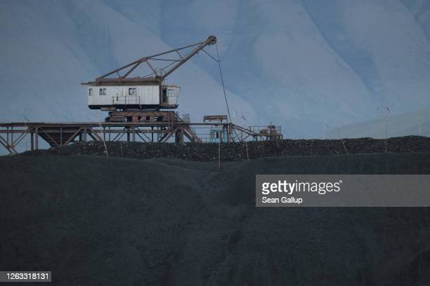 Machinery once used for loading coal from local mines onto ships stands over a pile of coal from the last remaining nearby operational mine on...