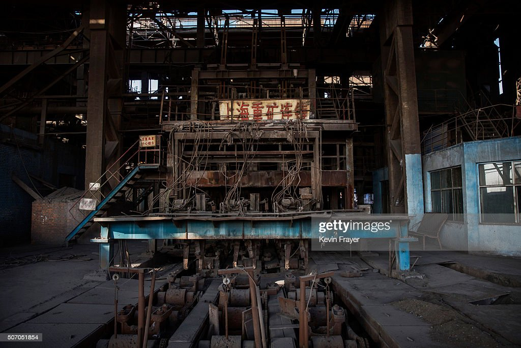 Machinery sits idle in the abandoned Qingquan Steel plantwhich closed in 2014 and became one of several so-called 'zombie factories', on January 26, 2016 in Tangshan, China. China's government plans to slash steel production by up to 150 million tons, which could see the loss of as many as 400,000 jobs according to state estimates. Officials point to excessive industrial capacity, a slump in demand and plunging prices as they attempt to restructure China's slowing economy. Hebei province, long regarded as China's steel belt, once accounted for nearly a quarter of the country's steel output. In recent years, state-owned steel mills have been shut down and dozens of small privately-owned plants in the area have gone bankrupt.