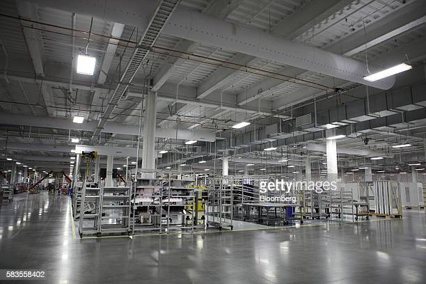 Machinery stands inside the Tesla Motors Inc Gigafactory in Sparks Nevada US on Tuesday July 26 2016 Tesla officially opened its Gigafactory on...
