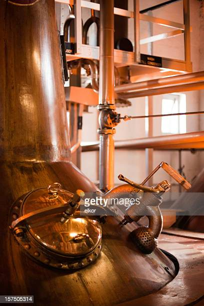 machines operating a whiskey distillery in islay, scotland  - whisky stock photos and pictures