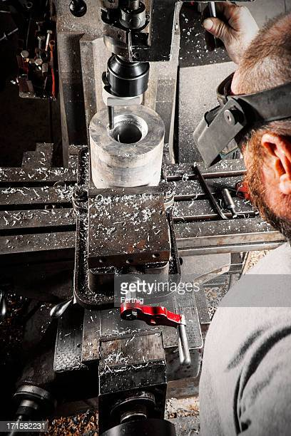 Machinist operating a metal-working milling machine