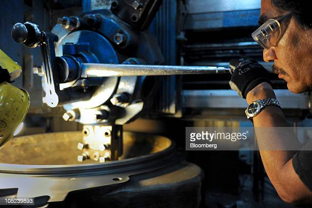 A machinist works at the Turbotec turbine refurbishing and assembly plant in Tijuana Mexico on Monday Oct 11 2010 Production at Mexican export...