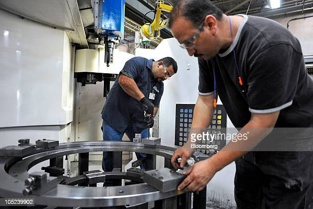 Machinists work at the Turbotec turbine refurbishing and assembly plant in Tijuana Mexico on Monday Oct 11 2010 Production at Mexican export...