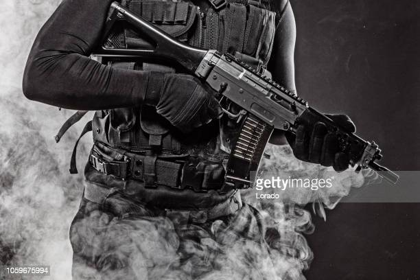 macho male military swat security anti terror member - swat stock pictures, royalty-free photos & images