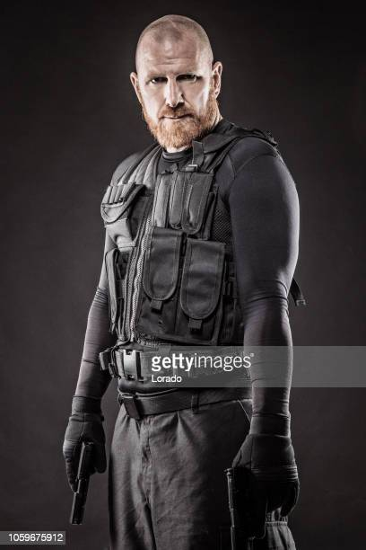 macho redhead male military swat security anti terror member - task force stock pictures, royalty-free photos & images