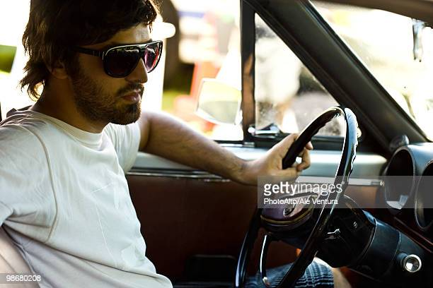 Macho young man driving