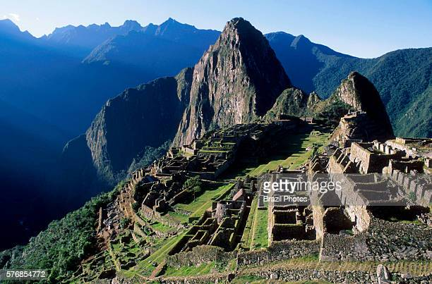 Machu Picchu a 15thcentury Inca citadel situated on a mountain ridge 2430 metres above sea level in the Cusco Region the most familiar icon of Inca...