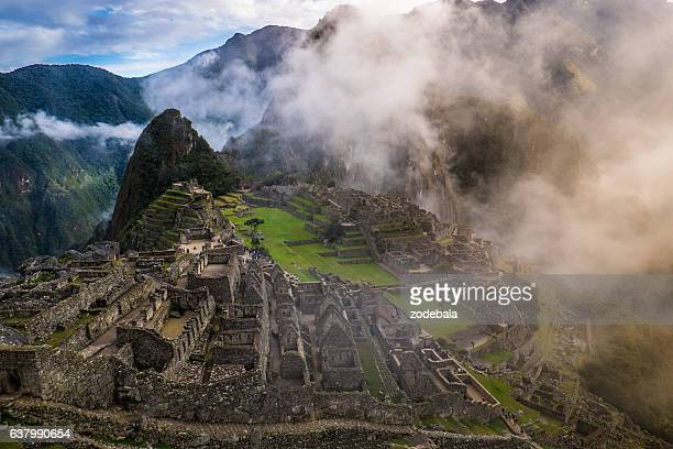 machu picchu at sunrise and clouds - ancient civilization stock photos and pictures