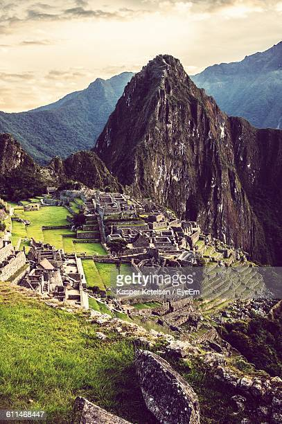 Machu Picchu By Mountains Against Sky