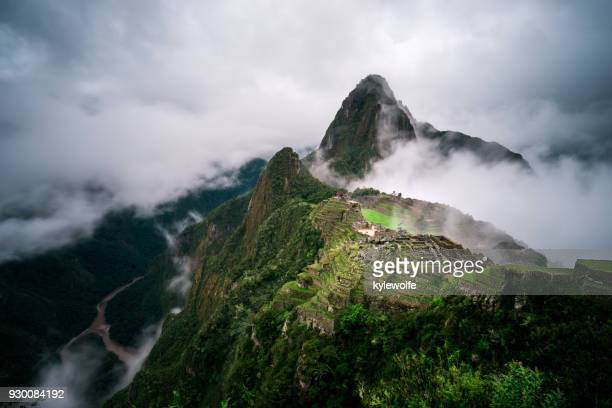 machu picchu in the fog, cuzco, peru - peru stock pictures, royalty-free photos & images