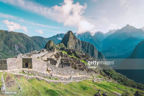 machu picchu inca ruins in the andes mountains - empire stock pictures, royalty-free photos & images