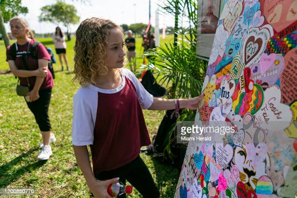 Maci Norkunas looks at a collage of art honoring the 17 victims killed at the Marjory Stoneman Douglas High School shooting. The art piece was on...
