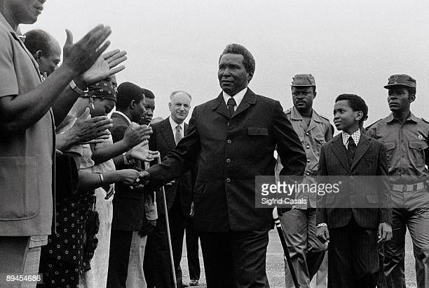 Macias President of Guinea in Malabo Macias dictator and president of Guinea in the airport of malabo Guinea followed by Teodoro Obiang