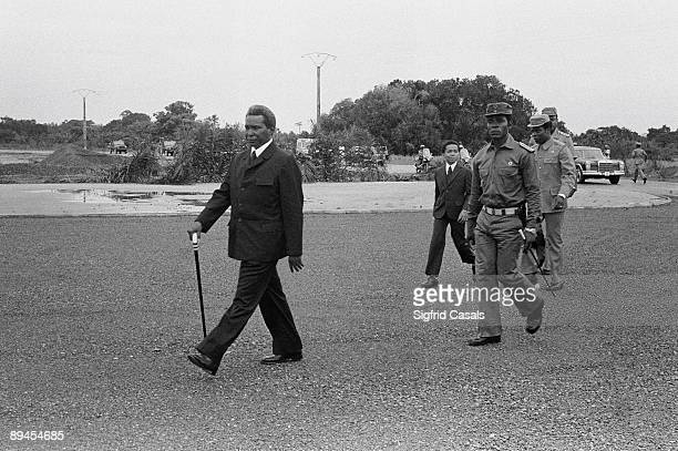 Macias President of Guinea in Malabo The Guinean dictator Macias walks across the landing strip of the airport of Malabo Guinea followed by Teodoro...