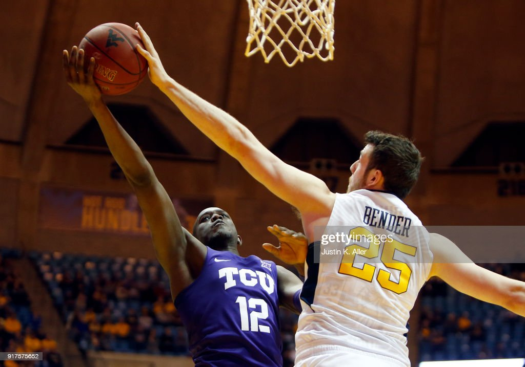 Maciej Bender #25 of the West Virginia Mountaineers blocks the shot of Kouat Noi #12 of the TCU Horned Frogs at the WVU Coliseum on February 12, 2018 in Morgantown, West Virginia.